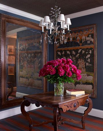entry way with antiques and dark pink flowers