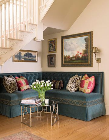 sitting area with turquoise velvet banquette chair