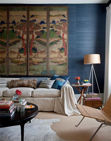 living room with mural and blue wall