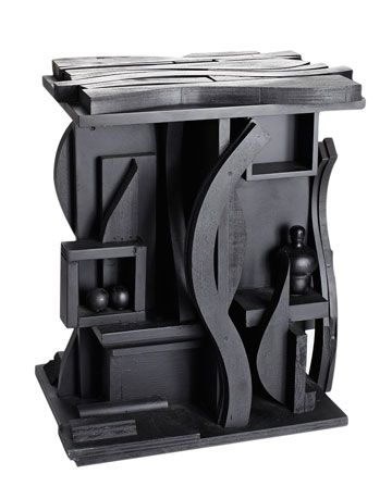 black wooden table with abstract details inspired by louise nevelson art