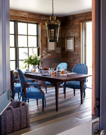 dining table with blue chairs in wood kitchen
