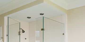 glass walled shower in white bathroom