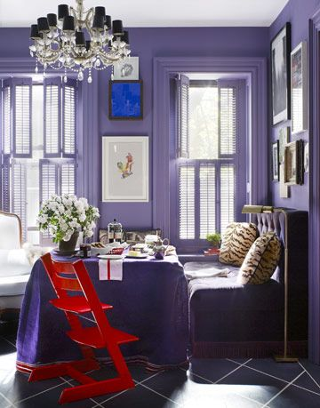 purple dining room with velvet banquet and red chair