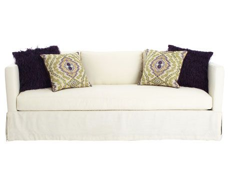 matching sets of pillows on white sofa