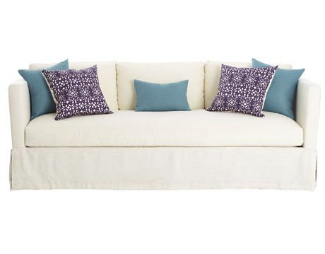 turquoise and purple pillows on white sofa