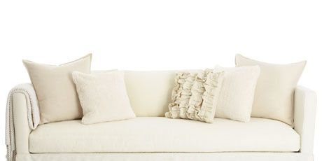 Cream And White Colored Pillows On Sofa