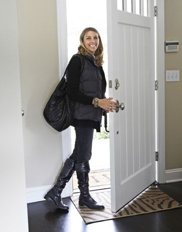 woman leaving house white front door