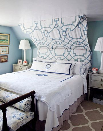 blue bedroom with white lamps and linens