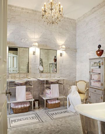 a chandelier hanging over an antique bathroom