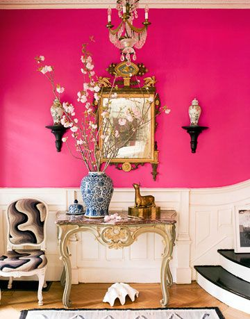 hot pink foyer with table mirror and black and white swirl chair