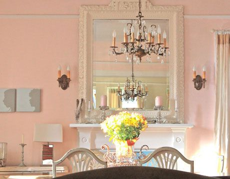 dining room with pink walls.