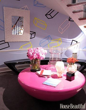 colorful foyer with pink table and black bench