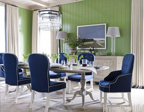 a blue and green dining room with a whitewashed table