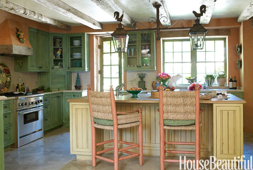 Kitchen With Green Cabinets And Orange Stools