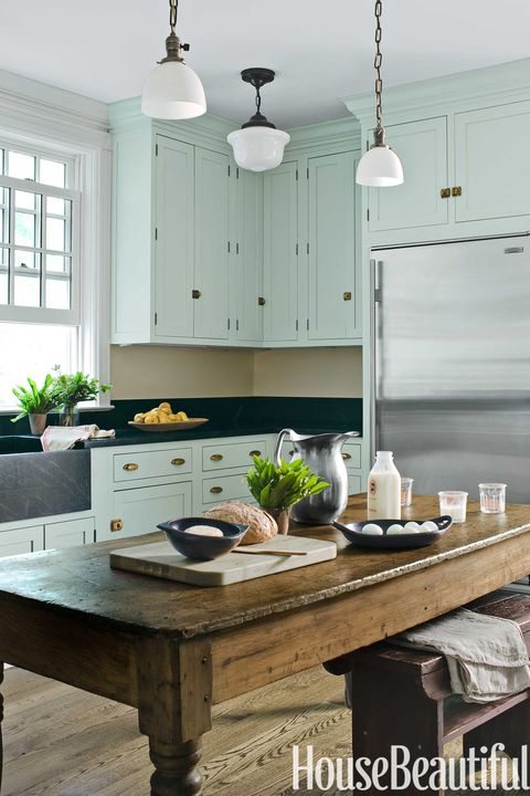 mint green kitchen with farmhouse table