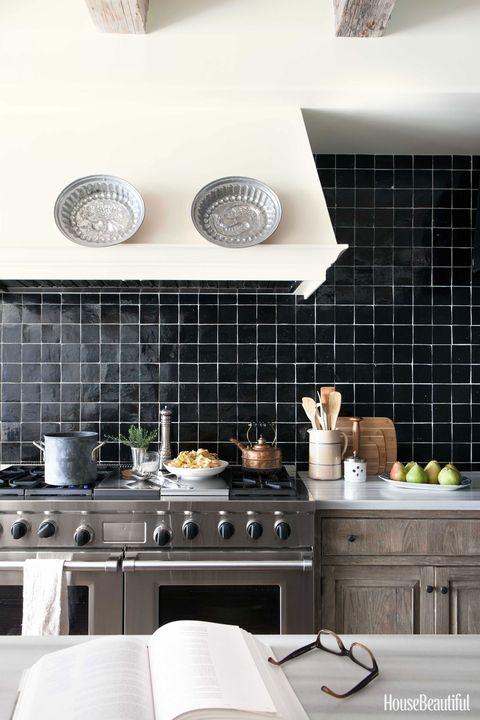 glazed black tile backsplash