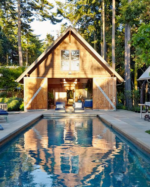 Watson And Reid Embellished The Rear Facade Of British Colonial Style House With A