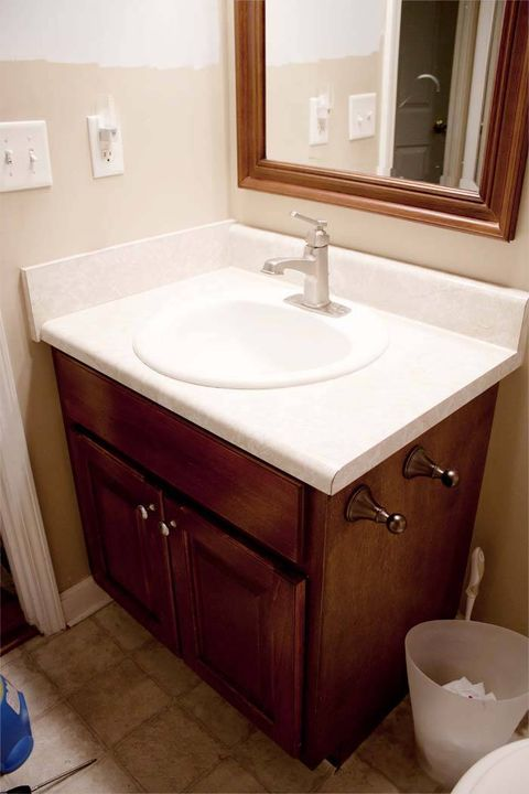 Wood, Plumbing fixture, Bathroom sink, Room, Architecture, Tap, Property, Interior design, Wall, Bathroom cabinet,