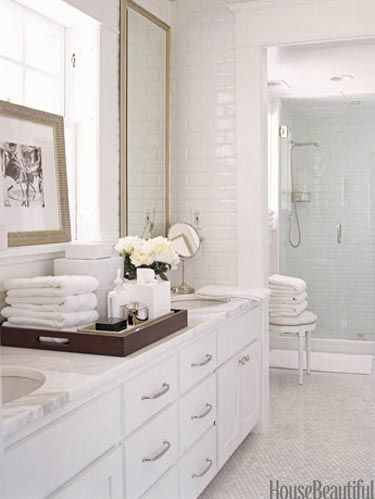 Bathrooms with Subway Tile - Using Subway Tile in a Bathroom on onyx in bathroom, shower tile in bathroom, hex tile in bathroom, dark counter in bathroom, chevron tile in bathroom, mosaic wall tile in bathroom, pinecones in bathroom, chairs in bathroom, wallpaper in bathroom, subway tile small bathroom remodeling, gray marble subway tile bathroom, countertops in bathroom, white in bathroom, subway tile wainscoting bathroom, wainscoting in bathroom, beveled subway tile bathroom, gray in bathroom, ceramic tile in bathroom, colored subway tile bathroom, border tile in bathroom,