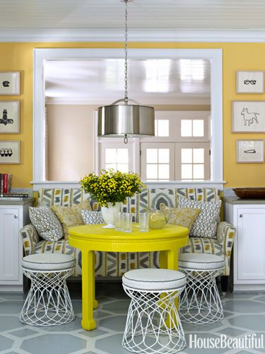 Dining Area With Yellow Walls And Yellow Table