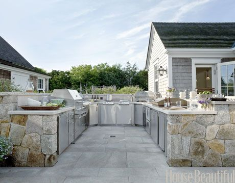 u shaped outdoor kitchen with stainless steel appliances