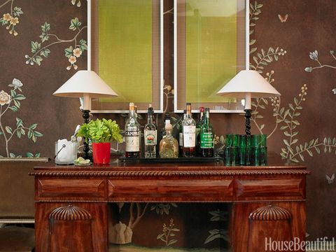 Room, Interior design, Lampshade, Bottle, Glass bottle, Interior design, Lamp, Drink, Lighting accessory, Wood stain,