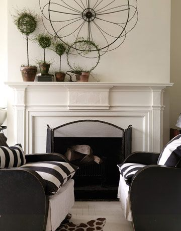 striped sofas by a fireplace