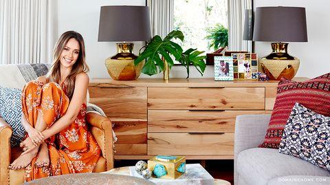 Orange, Room, Yellow, Furniture, Living room, Interior design, Peach, Formal wear, Textile, Home,