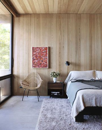 modern bedroom in wood and windows