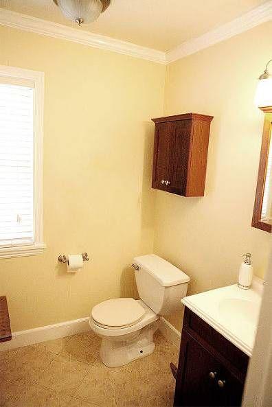 A Bland Powder Room is Transformed Into a Sleek Full Bathroom