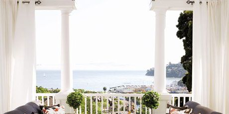 porch with wicker sofas and view of san francisco bay