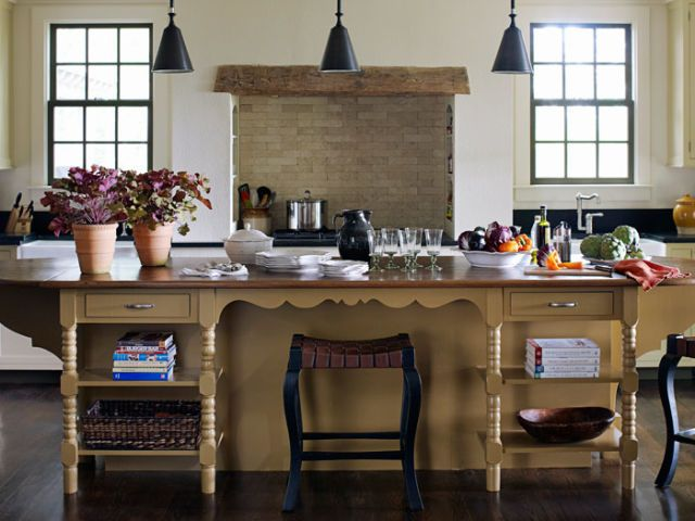 warm colored kitchen island with stools