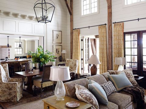 living room with dining room in the background in a barn inspired room