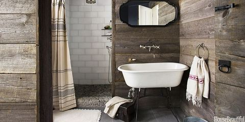 A Rustic, Country Bathroom with Barn Wood Walls