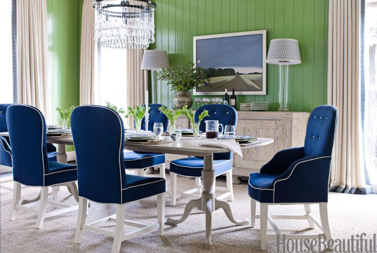 U Dining Area With Green Walls And A Blue Bench
