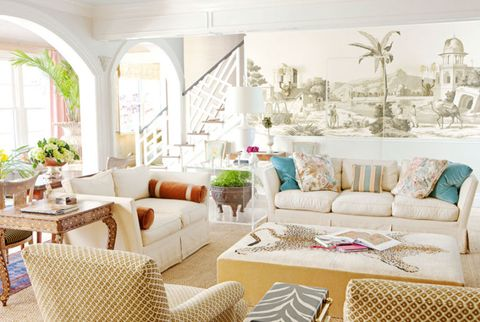 living room with large wall mural and white sofa