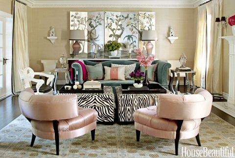 living room with pink chairs