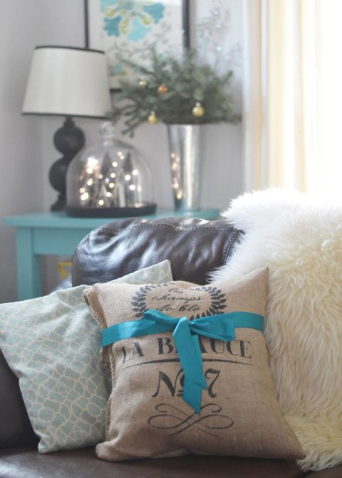 Textile, Interior design, Lamp, Lampshade, Teal, Grey, Turquoise, Fur, Interior design, Picture frame,