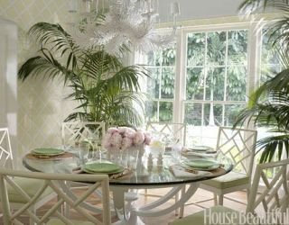 dining area with table and chairs and plants