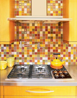 custom designed glass tile backsplash in a mosaic pattern