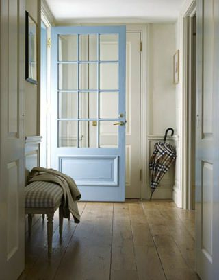 entry hall with blue door