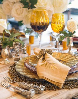 place setting with glasses plates flatware and napkin