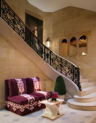 winding staircase with seating area in front of it