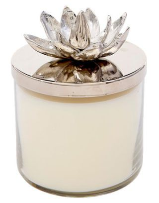 candle with flower on top