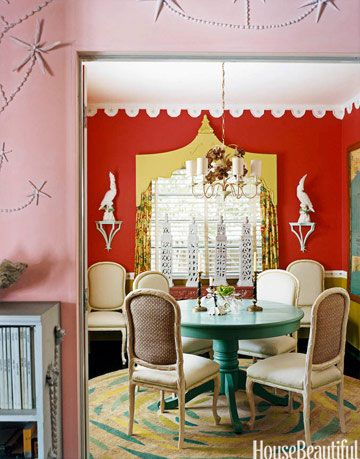 dining room with orange walls and turquoise table