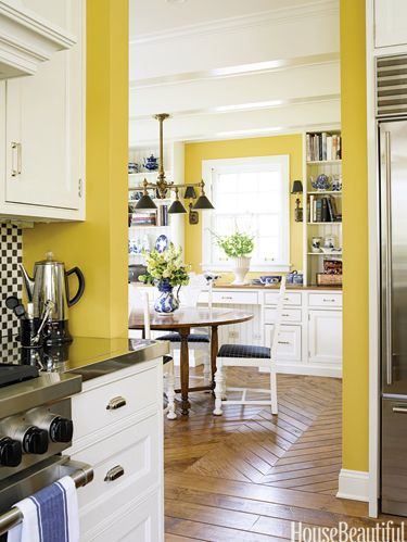 yellow kitchen with parquet floor
