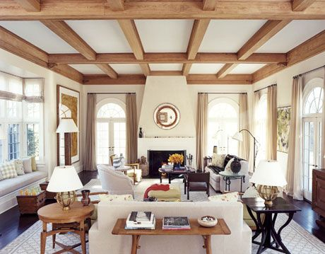 white living room with wood ceiling beams
