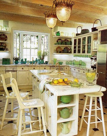 white kitchen with green and blue dishes and accessories