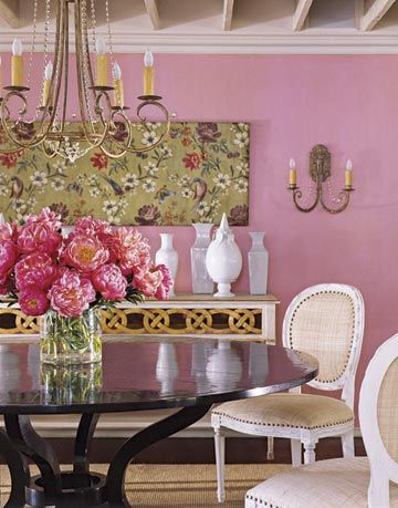 dining room with table chairs and pink walls