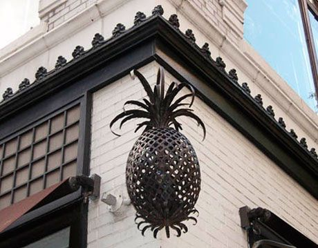pineapple sign outside store